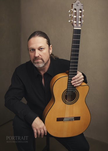 Portrait of Flamenco guitarrist by Mayumi Acosta Photography